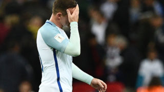England's captain Wayne Rooney leaves the pitch after the World Cup 2018 football qualification match between England and Malta at Wembley Stadium in London on October 8, 2016.  England won the game 2-0. / AFP PHOTO / Justin TALLIS