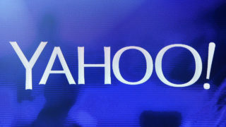 (FILES) This file photo taken on January 6, 2014 shows a Yahoo! logo  on a screen during a keynote address by Yahoo! in Las Vegas, Nevada.  Yahoo on October 4, 2016 unveiled its latest mobile news application, using both algorithms and user choices to deliver the most relevant updates with a social twist.Yahoo Newsroom, tailored for mobile devices powered by Android or Apple operating systems, is Yahoo's latest move to counter Facebook and other internet giants as a key place for news updates.  / AFP PHOTO / GETTY IMAGES NORTH AMERICA / Ethan Miller