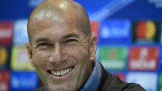 Real Madrid's French coach Zinedine Zidane smiles during a press conference at Valdebebas Sport City in Madrid on October 17, 2016 on the eve of their Champions League football match against Legia Warszawa. / AFP PHOTO / PIERRE-PHILIPPE MARCOU