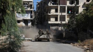 Syrian pro-government forces take part in an operation to take control of Aleppo's Suleiman al-Halabi neighbourhood, which is divided by the frontline that separates the rebel-held east and regime-held west of the northern city, on September 30, 2016. Syrian regime forces advanced in the battleground city of Aleppo, backed by a Russian air campaign that a monitor said has killed over 3,800 civilians in the past year. PHOTO: GEORGES OURFALIAN / AFP