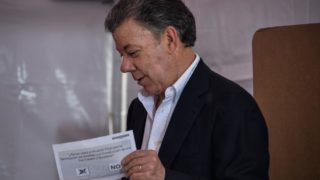 Colombian President Juan Manuel Santos casts his vote during a referendum on whether to ratify a historic peace accord to end a 52-year war between the state and the communist FARC rebels, in Bogota on October 2, 2016. The accord will effectively end what is seen as the last major armed conflict in the Western Hemisphere. The war has killed hundreds of thousands of people and displaced millions. GUILLERMO LEGARIA / AFP