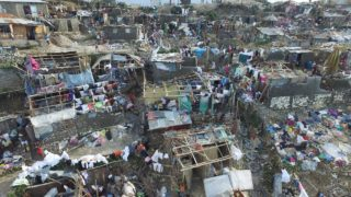 Homes destroyed and damaged by Hurricane Matthew are seen in Jeremie, in western Haiti, on October 7, 2016. The full scale of the devastation in hurricane-hit rural Haiti became clear as the death toll surged over 400, three days after Hurricane Matthew leveled huge swaths of the country's south. PHOTO: Nicolas GARCIA / AFP