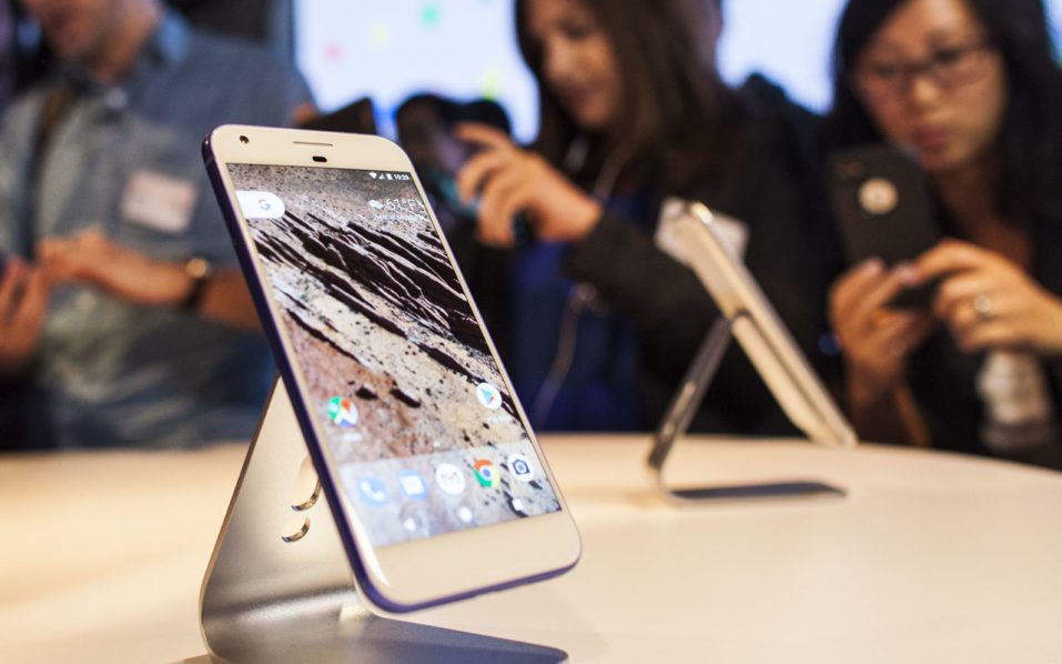 SAN FRANCISCO, CA - OCTOBER 04: Members of the media examine Google's Pixel phone during an event to introduce Google hardware products on October 4, 2016 in San Francisco, California. Google unveils new products including the Google Pixel Phone making a jump into the mobile device market.   Ramin Talaie/Getty Images/AFP