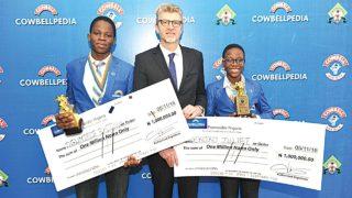 Winner, 2016 Cowbellpedia Mathematics Quiz Competition, (senior category), Oguntade Ayoola (left); Managing Director, Promasidor Nigeria Limited, Olivier Thiry, and winner, junior category of the competition,Juliet Ekoko at the grand finale of the contest