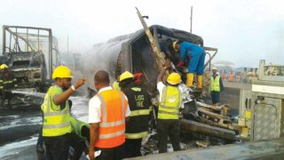 Fire fighters at the scene of Wednesday's accident along Lagos-Ibadan Express Way.