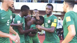 The Super Eagles celebrating Victor Moses' opening goal against Algeria during their 2018 FIFA World Cup qualifier at the Godswill Akpabio Stadium, Uyo… on Saturday.								            PHOTO: AFP.
