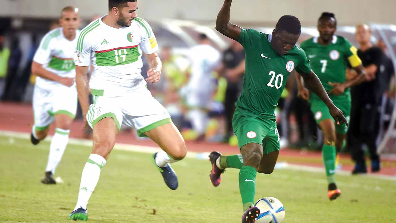 Super Eagles' Etebo Oghenekaro (right) tries to outwit Algeria's Mehdi Abeid during their 2018 FIFA World Cup qualifier in Uyo…at the weekend. PHOTO: AFP.