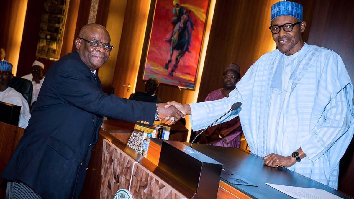 Justice Walter Onnoghen in a handshake with President Muhammadu Buhari