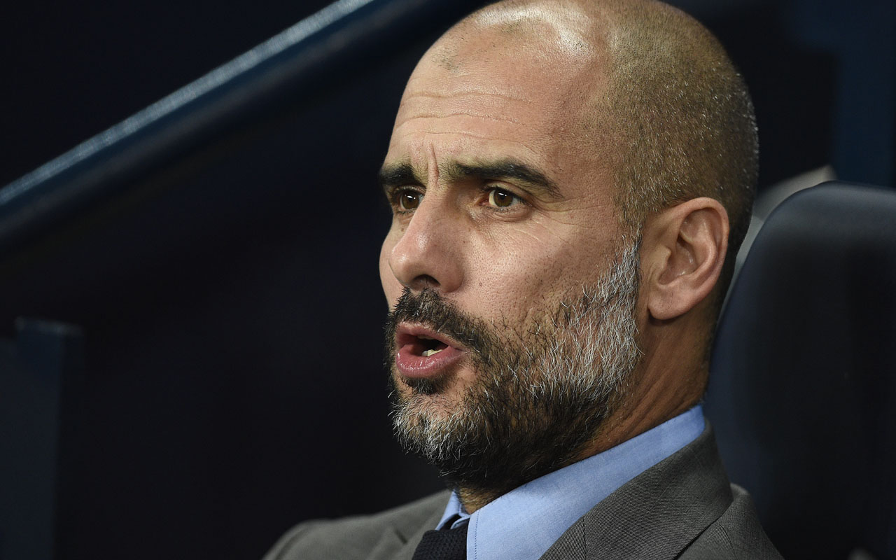 Manchester City's Spanish manager Pep Guardiola  / AFP PHOTO / OLI SCARFF