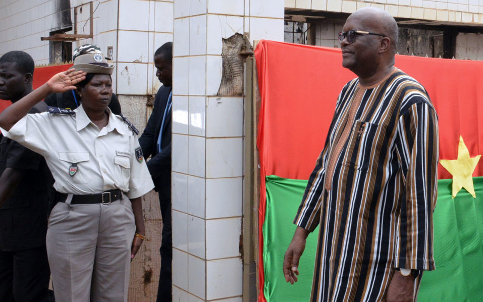 Burkinabe president Roch Marc Christian Kabore (R) arrives at the parliament to celebrate the second anniversary of the civil unrest that led to the dismissal of the former president Blaise Compaore on October 31, 2016, in Ouagadougou. / AFP PHOTO / Ahmed OUOBA