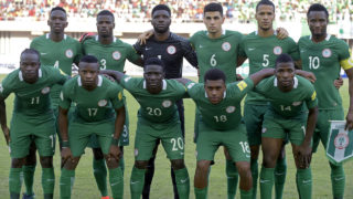 Nigeria's squad (back L-R) defender Kenneth Omeruo, defender Elderson Uwa Echiejile, goalkeeper Daniel Akpeyi, defender Leon Balogun, defender William Troost-Ekong, midfielder John Obi Mikel, (L-R) midfielder Victor Moses, midfielder Ogenyi Onazi, forward Oghenekaro Etebo, forward Alex Iwobi and forward Kelechi Iheanacho pose for a group picture ahead of the 2018 FIFA World Cup African zone group B qualifying football match between Nigeria and Algeria at the Akwa Ibom State Stadium in Uyo on November 12, 2016. / AFP PHOTO / PIUS UTOMI EKPEI