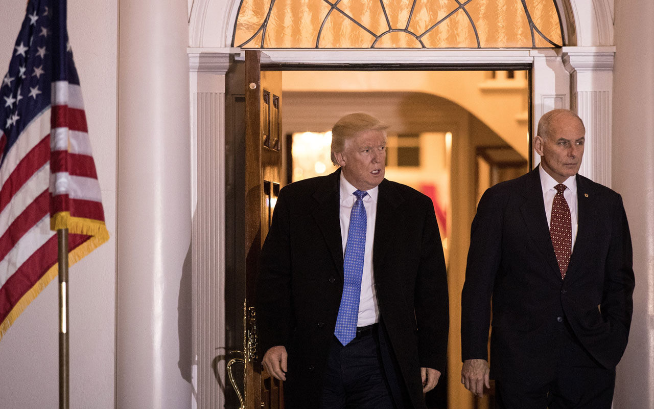 BEDMINSTER TOWNSHIP, NJ - NOVEMBER 20: (L to R) President-elect Donald Trump and U.S. Marine Corps General John Kelly emerge from the clubhouse following their meeting at Trump International Golf Club, November 20, 2016 in Bedminster Township, New Jersey. Trump and his transition team are in the process of filling cabinet and other high level positions for the new administration. Drew Angerer/Getty Images/AFP
