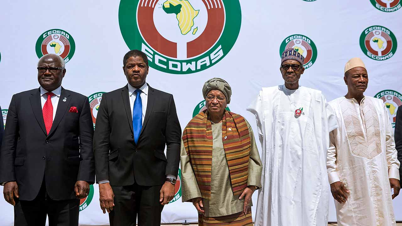 (From L) Sierra Leon's President Ernest Bai Koroma, President of ECOWAS official Marcel Alain de Souza, Liberian President and Ecowas Chairperson Ellen Johnson Sirleaf, Nigerian President Muhammadu Buhari (R) and Guinean President Alpha Conde (C) pose during the 50th summit of the 15-member Economic Community of West African States (ECOWAS) in Abuja, on December 17, 2016. West African leaders have called for a swift resolution of the political impasse in The Gambia after disputed elections in which long-term president Yahya Jammeh is refusing to concede defeat. The appeal came at the 50th summit of the 15-member Economic Community of West African States (ECOWAS) in Nigeria, attended by 11 heads of state but without the leaders of four members including The Gambia. PHOTO: Pius Utomi EKPEI / AFP