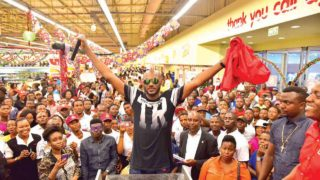 2Baba poses with fans during the draw at the Ikeja City Mall, Lagos.