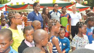 Government officials and sponsors with children from orphanages and care homes during the christmas party.