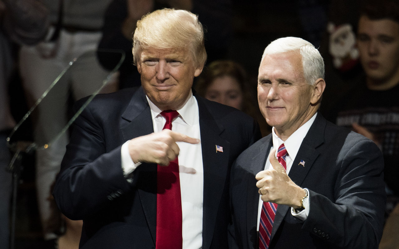 President-elect Donald Trump and Vice President-elect Mike Pence stand onstage together at U.S. Bank Arena on December 1, 2016 in Cincinnati, Ohio. Trump took time off from selecting the cabinet for his incoming administration to celebrate his victory in the general election. Ty Wright/Getty Images/AFP