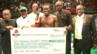 "Chairman, Ikorodu United Football Club, Babatunde Akindele (left); Managing Director, MultiChoice Nigeria, John Ugbe; CEO, Flykite Promotions, Jenkins Alumona; Stanley ""Edoboy"" Eribo; Adebayo Shoboye and President General of the Nigeria Football Supporters Club, Rafiu Ladipo, presenting an award to GOtv Boxing Night 10 Best Boxer, Edoboy, at the Indoor Sports Hall of the National Stadium, Lagos… on Monday."