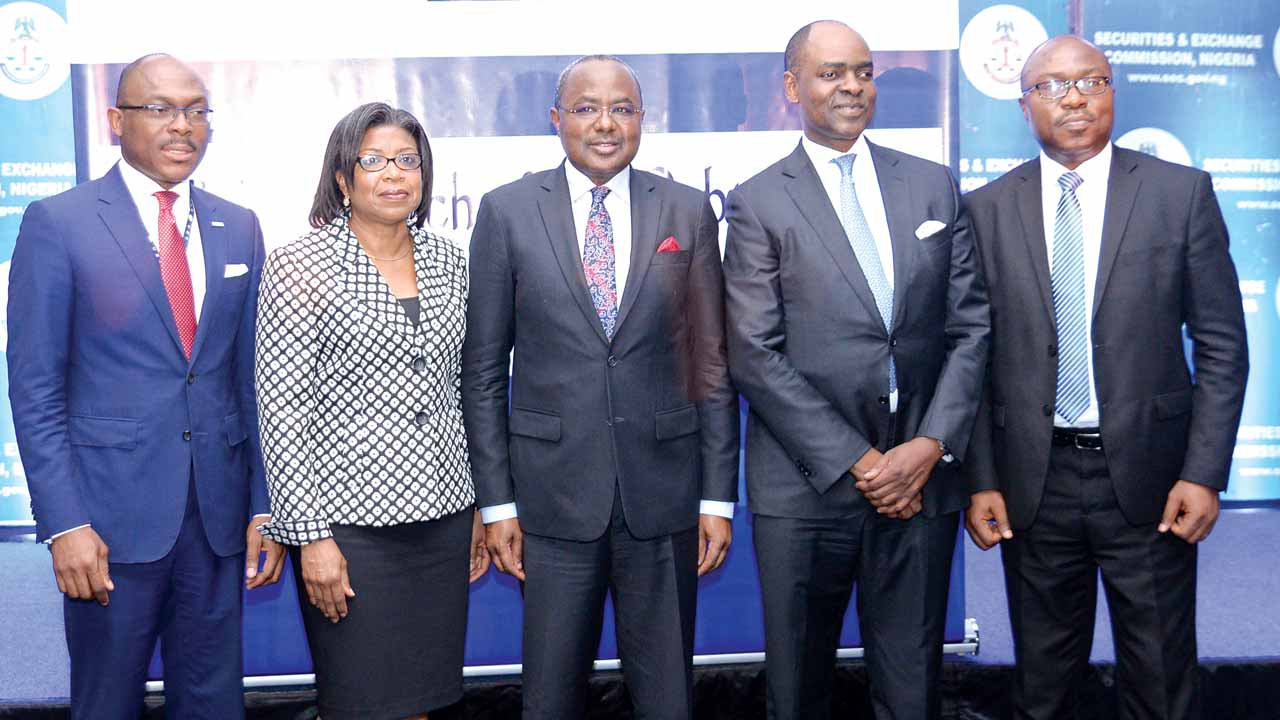 Managing Director/Chief Executive Officer, FMDQ OTC Securities Exchange, Bola Onadele (left); Head, Efficiency Unit, Ministry of Finance, Ms. Patience Oniha; Director-General, Securities and Exchange Commission (SEC), Mounir Gwarzo; Chief Executive Officer, Chapel Hill Denham Group, Bolaji Balogun; and Head Investment Supervision Department, National Pension Commission, Ehimeme Ohioma during the launch of the DCMD Project at SEC's third quarter Capital Market Committee meeting in Lagos.