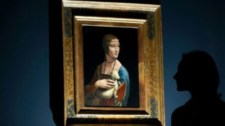 Painting entitled 'Portrait of Cecilia Gallerani' (The Lady with an Ermine) by Leonardo da Vinci at the National Gallery in London (AFP Photo/CARL COURT)
