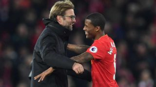 Liverpool's German manager Jurgen Klopp (L) celebrates on the pitch with goalscorer Liverpool's Dutch midfielder Georginio Wijnaldum after the English Premier League football match between Liverpool and Manchester City at Anfield in Liverpool, north west England on December 31, 2016. Liverpool won the game 1-0. Paul ELLIS / AFP