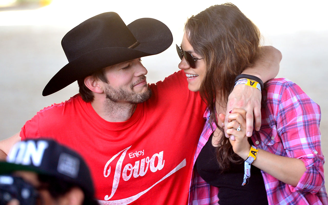 actors Ashton Kutcher (L) and Mila Kunis attending day 1 of 2014 Stagecoach: California's Country Music Festival in Indio, California. Featured couple Mila Kunis and Ashton Kutcher welcomed their second child, a boy born Wednesday, say several US media on Thursday, quoting a spokeswoman for the actress. The star couple had secretly married in July 2015 and have a two-year-old daughter, Wyatt. / AFP PHOTO / GETTY IMAGES NORTH AMERICA / Frazer Harrison