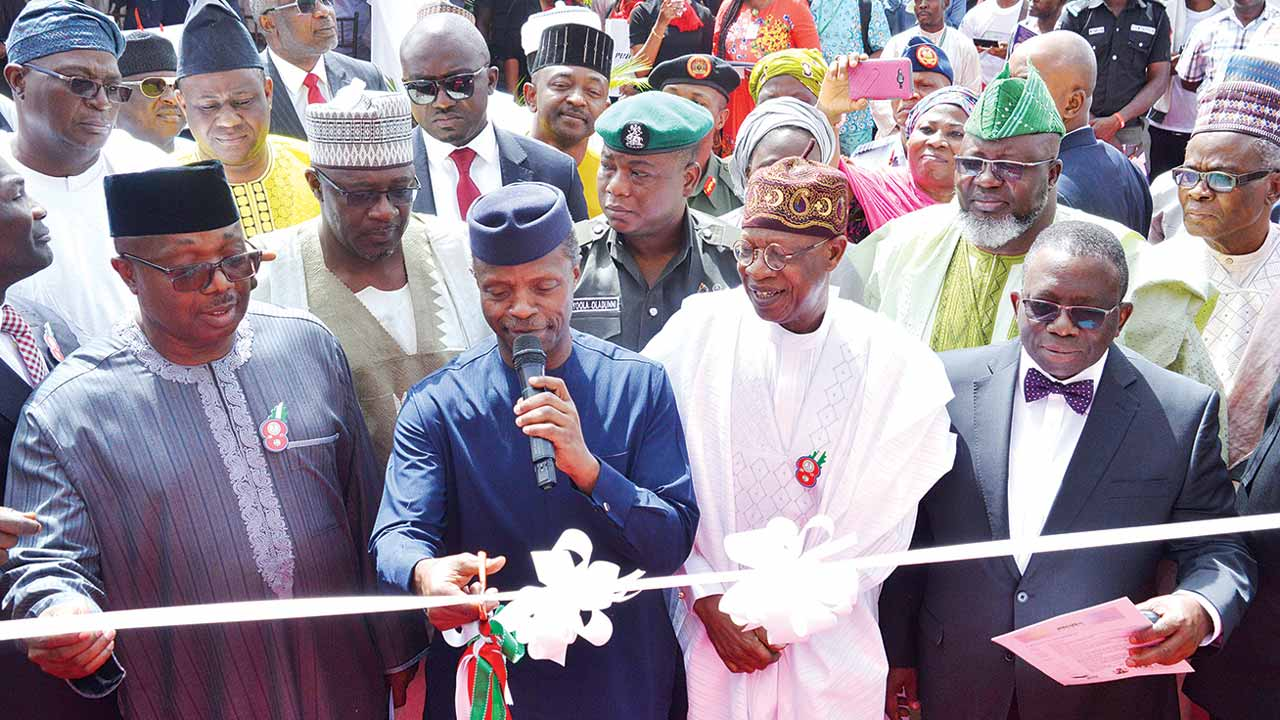 Minister of State for Health, Dr. Osagie Ehanire (left), Vice President Yemi Osinbajo, Minister of Information, Alhaji Lai Mohammed, Minister of Health, Prof. Isaac Adewole and others while launching Abuja digital switchover (DSO) in Abuja.