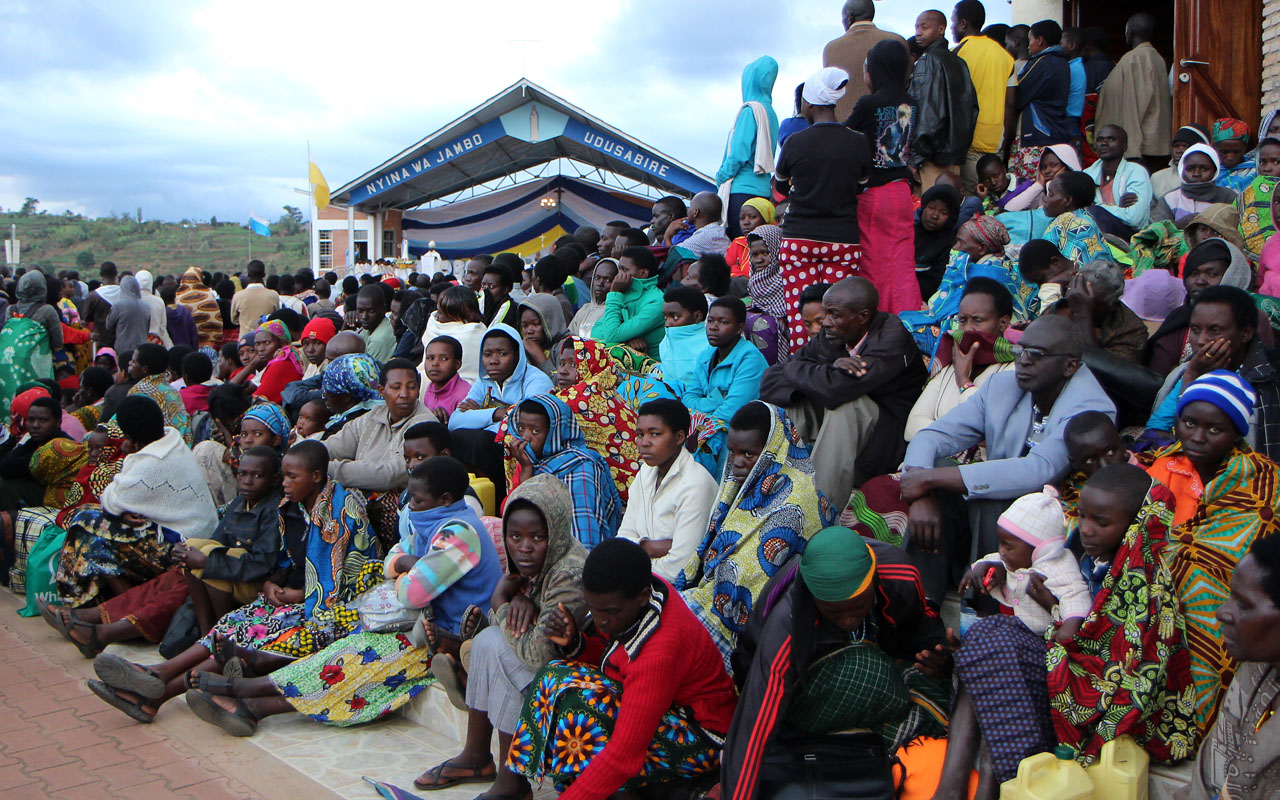 Catholic pilgrims gather for celebrations in Kibeho in southern Rwanda on November 28, 2016 to mark the anniversary of the reported apparition of the Virgin Mary in 1981 in the hope of receiving miracles and being healed from illnesses and disabilities. Kibeho has become a little Lourdes with pilgrims flocking to southern Rwanda in hopes of a miracle, 35 years after three Rwandan women had a vision, a vision that was later recognised by the Catholic Church and is now regarded by some as a premonition of the Rwandan Genocide. / AFP PHOTO / STEPHANIE AGLIETTI
