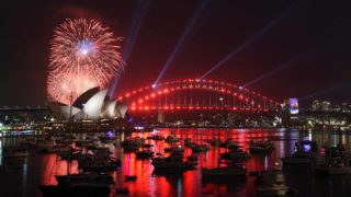 A family fireworks illuminates the sky above the iconic Opera House in Sydney on December 31, 2016, ahead of New Years fireworks.  SAEED KHAN / AFP