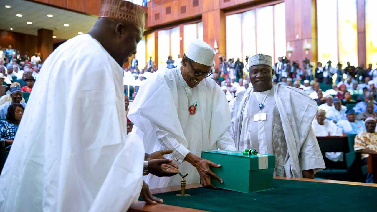 President Muhammadu Buhari (C) presenting copies of the 2017 budget documents to the National Assembly on Wednesday, December 14, 2016.
