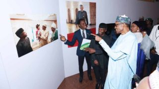 From Left: Bayo Omoboriowo, Personal Photographer to President Muhammadu Buhari and the author of the book, Buhari: A New Beginning, Vice President Yemi Osinbajo and President Muhammadu Buhari