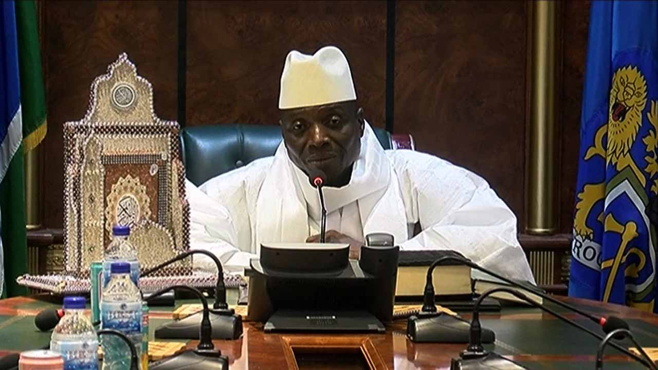 "An image grab taken on December 3, 2016 from a video of the Gambia and Television Services (GRTS) broadcasted on December 2, 2016, in Banjul shows outgoing Gambian President Yahya Jammeh speaking during a press conference after being defeated during the presidential election. Jammeh conceded defeat to opposition leader Adama Barrow on December 2, 2016 accepting that Gambians had ""decided that I should take the backseat"". The Gambia's President-elect Adama Barrow was to hold talks with his coalition the day after to plot his transition to power, following a shock election victory that ended the 22-year rule of Yahya Jammeh. Handout / GRTS - Gambia Radio and Television Services / AFP"