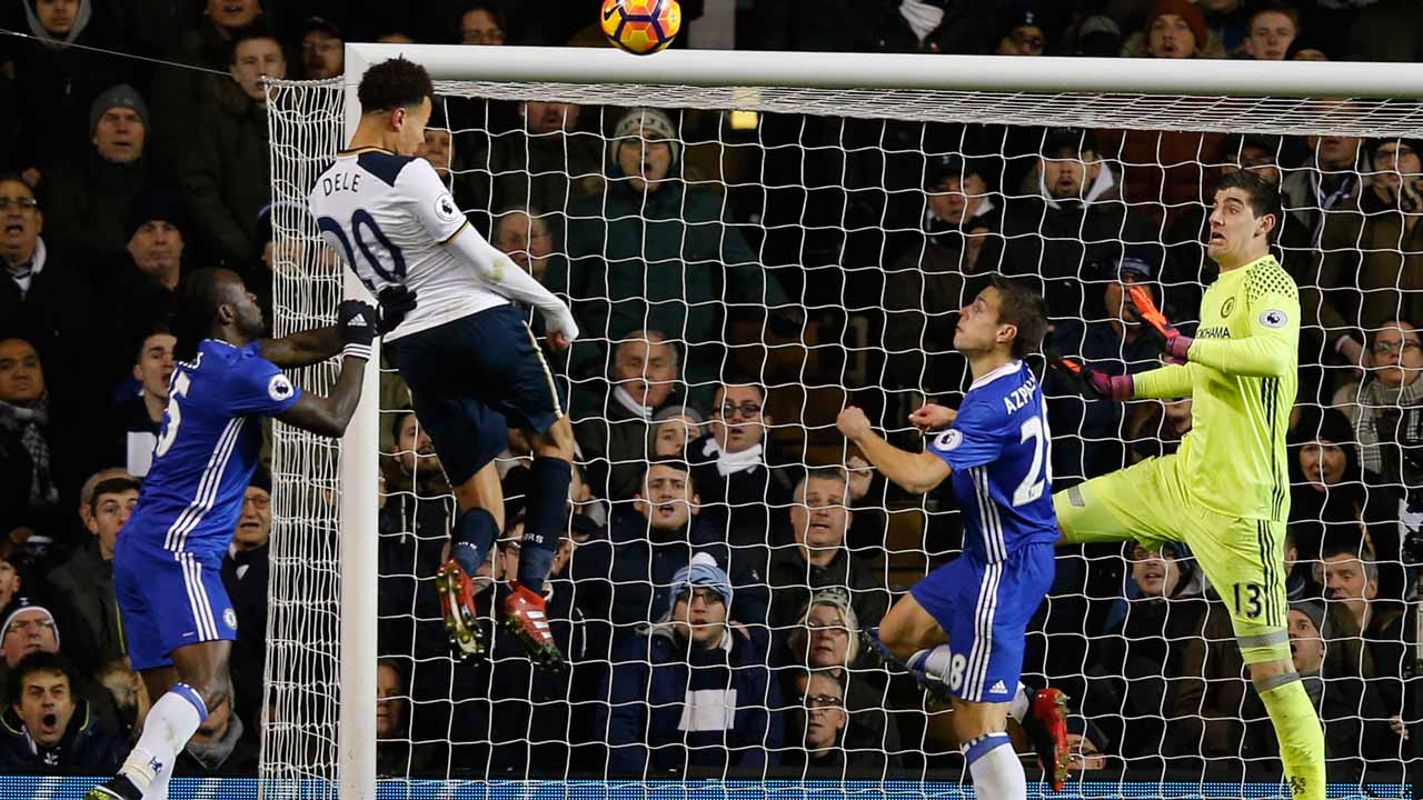 Tottenham Hotspur's English midfielder Dele Alli (2nd L) jumps to score his and Totenham's second goal with this header during the English Premier League football match between Tottenham Hotspur and Chelsea at White Hart Lane in London, on January 4, 2017. PHOTO: Adrian DENNIS / AFP