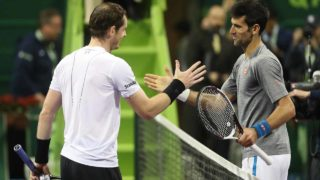 Britain's Andy Murray (L) congratulates Serbia's Novak Djokovic on winning during their final tennis match at the ATP Qatar Open in Doha on January 7, 2017. PHOTO: KARIM JAAFAR / AFP