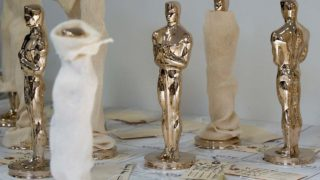 Unfinished bronze Oscar statuettes, some in a sock for protection, stand January 13, 2017 at Polich Tallix Foundary in Rock Tavern, Upstate New York. A stylized figure of a knight holding a crusader's sword standing on a reel of film with five spokes signifying the five original branches of the Academy (actors, directors, producers, technicians and writers) is widely considered the most prestigious cinema award trophy. DON EMMERT / AFP