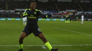 Arsenal's Nigerian striker Alex Iwobi celebrates his team's second goal after his shot was defelected into goal off Swansea City's English midfielder Jack Cork (unseen) during the English Premier League football match between Swansea City and Arsenal at The Liberty Stadium in Swansea, south Wales on January 14, 2017. Geoff CADDICK / AFP