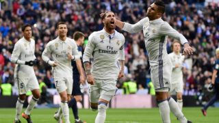 Real Madrid's defender Sergio Ramos (L) celebrates with Real Madrid's Brazilian midfielder Casemiro after scoring during the Spanish league football match Real Madrid CF vs Malaga CF at the Santiago Bernabeu stadium in Madrid on January 21, 2017.  PIERRE-PHILIPPE MARCOU / AFP