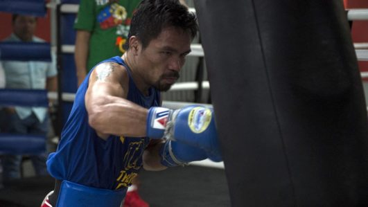 (FILES) This file photo taken on September 29, 2016 shows Philippine boxer Manny Pacquiao training at a gym in Manila. WBO welterweight world champion Manny Pacquiao is willing to square up with mixed martial arts star Conor McGregor if his potential superfight with Floyd Mayweather fails to materialise, a spokesman said on January 22, 2017.  TED ALJIBE / AFP