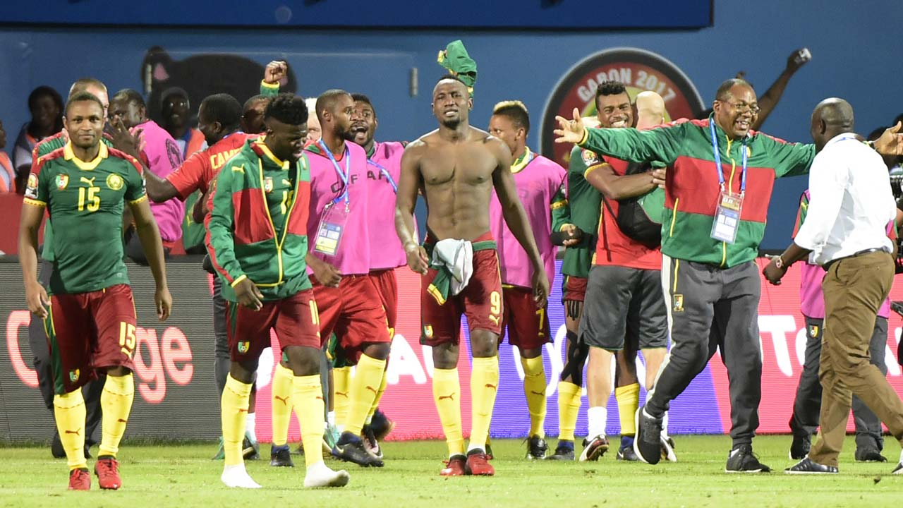 Cameroon's players celebrate at the end of the 2017 Africa Cup of Nations quarter-final football match between Senegal and Cameroon in Franceville on January 28, 2017. PHOTO: KHALED DESOUKI / AFP