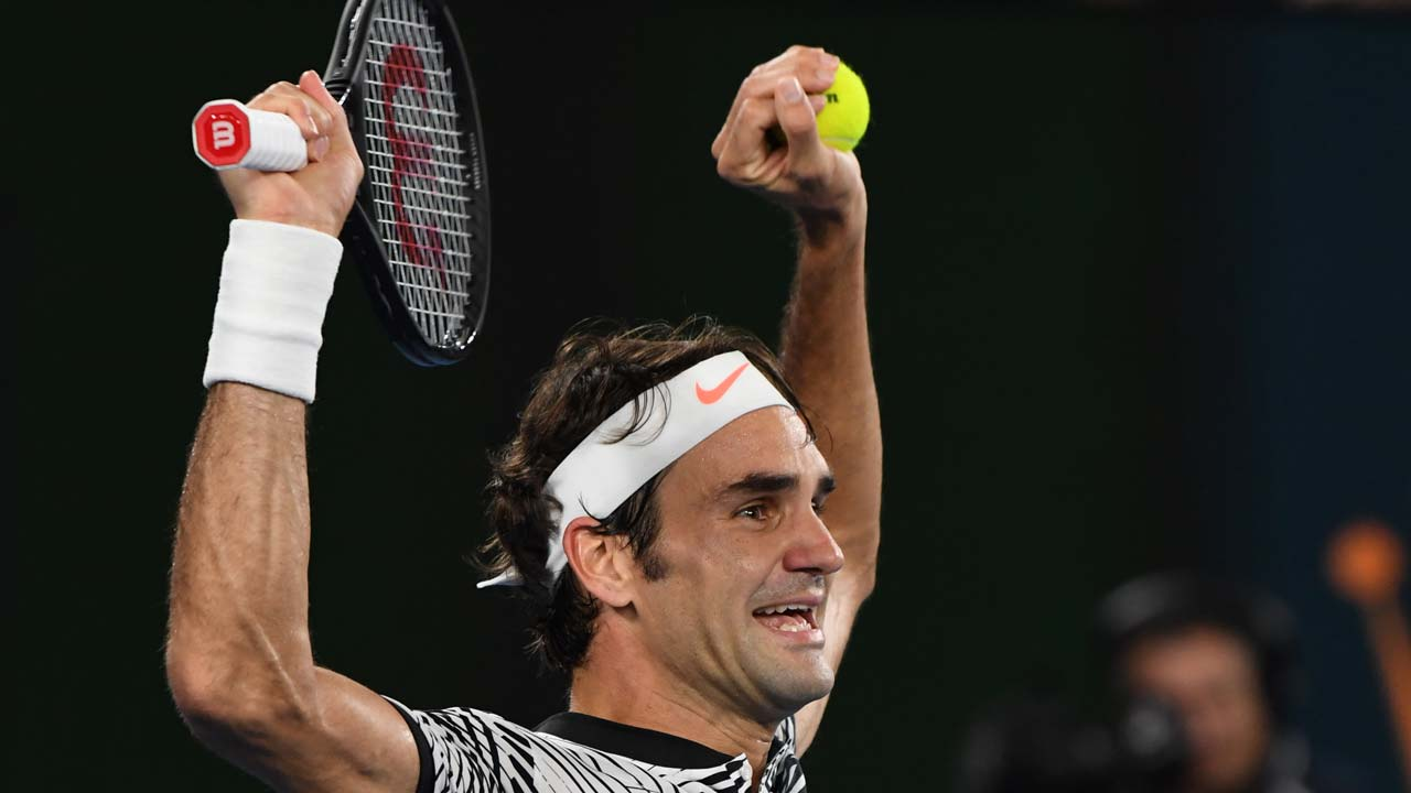 Switzerland's Roger Federer celebrates his victory against Spain's Rafael Nadal during the men's singles final on day 14 of the Australian Open tennis tournament in Melbourne on January 29, 2017.  GREG WOOD / AFP