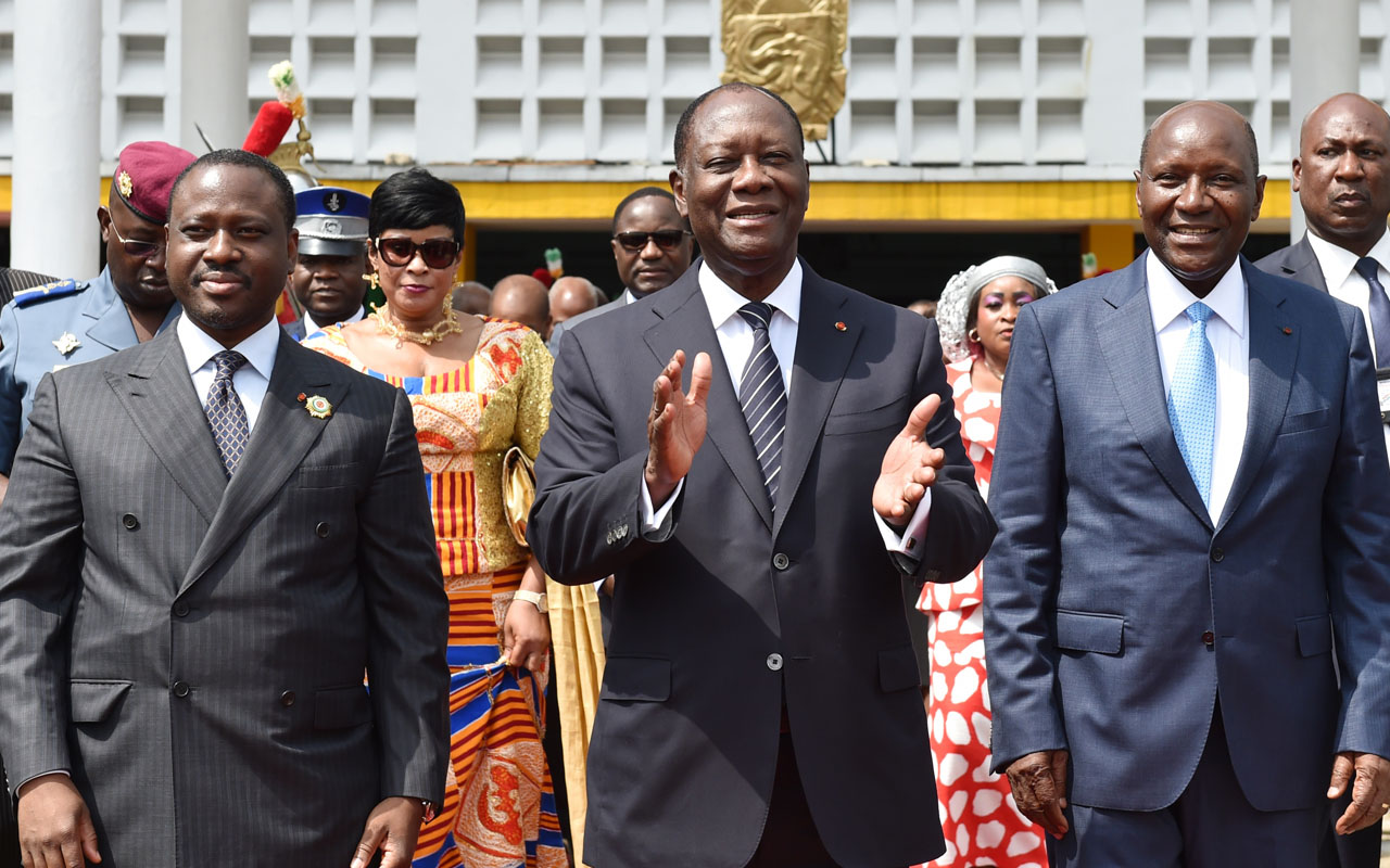 Ivorian President Alassane Ouattara (C), flanked by newly re-elected Ivorian National Assembly president Guillaume Soro (L) and former Ivorian prime minister and newly appointed Ivory Coast's Vice-President Daniel Kablan Duncan, walks out the National Assembly in Abidjan on January 10, 2017. Former Ivorian prime minister Kablan Duncan, who resigned along with his government on January 9, has been appointed Ivory Coast's Vice-President on January 10, 2017. Ivory Coast initiated a post-election reshuffle on January 9 and fired the heads of its armed forces and police after a brief army mutiny that stoked security fears in the world's top cocoa producer. / AFP PHOTO / ISSOUF SANOGO
