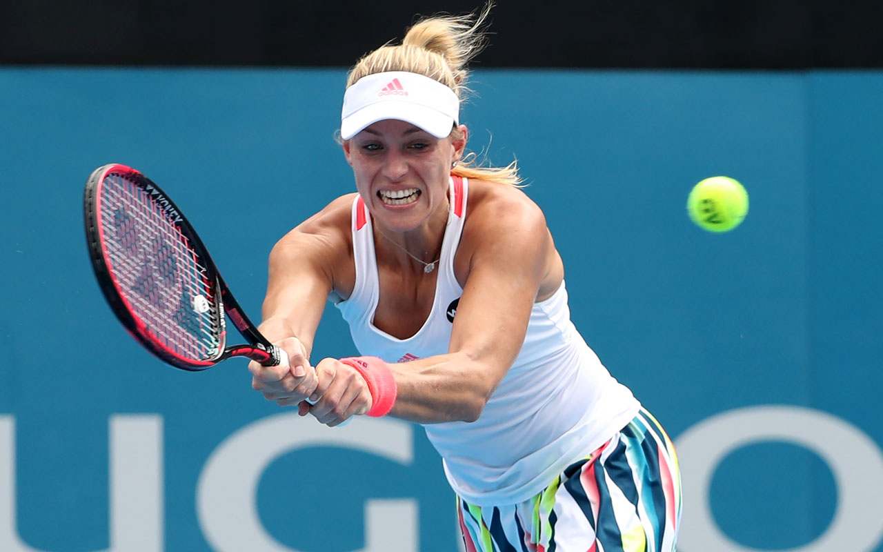 Angelique Kerber of Germany hits a return to Daria Kasatkina of Russia in their women's singles second round match at the Sydney International tennis tournament in Sydney on January 10, 2017. / AFP PHOTO / GLENN NICHOLLS / IMAGE