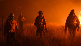Firemen fight a wildfire near La Adela in La Pampa Province on January 5, 2017. Firefighters in Argentina said on January 5 they were bringing under control three wildfires that have devastated nearly a million hectares (2.5 million acres) of the country's famous pampas, or plains. / AFP PHOTO / Eitan ABRAMOVICH