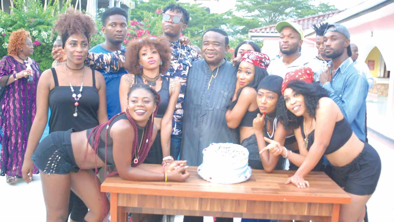 Okoroji (middle) with models at the video shoot in Lagos.