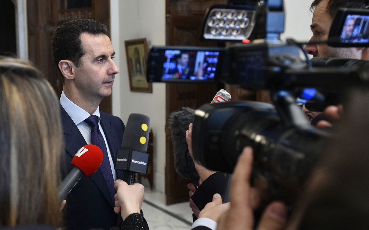 """Syrian President Bashar al-Assad  / AFP PHOTO / SANA / HO / RESTRICTED TO EDITORIAL USE - MANDATORY CREDIT """"AFP PHOTO / SANA"""" - NO MARKETING - NO ADVERTISING CAMPAIGNS - DISTRIBUTED AS A SERVICE TO CLIENTS"""