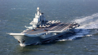 (FILES) This file photo taken on December 24, 2016 shows the Liaoning, China's only aircraft carrier, sailing during military drills in the Pacific. China's only aircraft carrier has entered the Taiwan Strait in a highly symbolic show of strength, but Taiwan insisted on January 11, 2017 there was no need for panic even as tensions boil over the island's diplomatic status. / AFP PHOTO / STR / China OUT