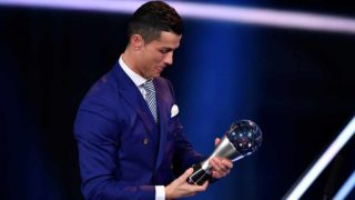 Real Madrid and Portugal's forward Cristiano Ronaldo holds his trophy after winning the The Best FIFA Men's Player of 2016 Award during The Best FIFA Football Awards ceremony, on January 9, 2017 in Zurich.  Fabrice COFFRINI / AFP