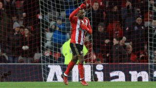 Sunderland's English striker Jermain Defoe celebrates after scoring their second goal from the penalty spot during the English Premier League football match between Sunderland and Liverpool at the Stadium of Light in Sunderland, north-east England on January 2, 2017.  Lindsey PARNABY / AFP