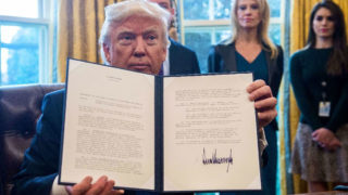 US President Donald Trump shows one of the executive orders he signed in the Oval Office at the White House on January 24, 2017 US President Donald Trump shows one of the executive orders he signed in the Oval Office at the White House on January 24, 2017 (AFP Photo/NICHOLAS KAMM)