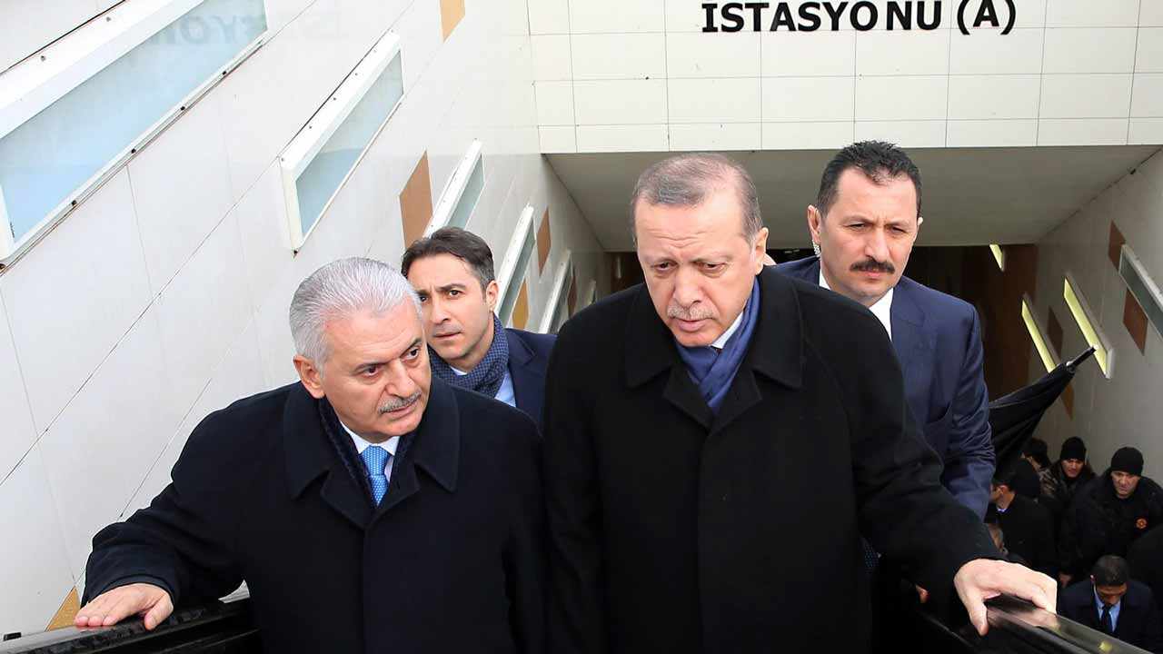 In this handout made available by the Turkish Presidential Press Office on January 5, 2017, Turkish President Recep Tayyip Erdogan (2nd R) and Turkish Prime Minister Binali Yildirim (L) use the metro escalator during the opening ceremony of the new metro line in Kecioren District of Ankara. YASIN BULBUL / AFP TURKISH PRESIDENTIAL PRESS OFFICE / AFP