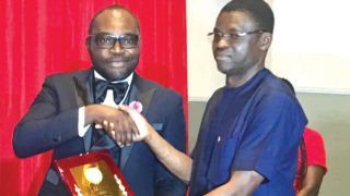 Chairman FROT Group, Frank Momoh (left) receives the Outstanding Sports Personality of the Year award from Edo State Deputy Governor, Philip Shaibu in Benin City.. recently
